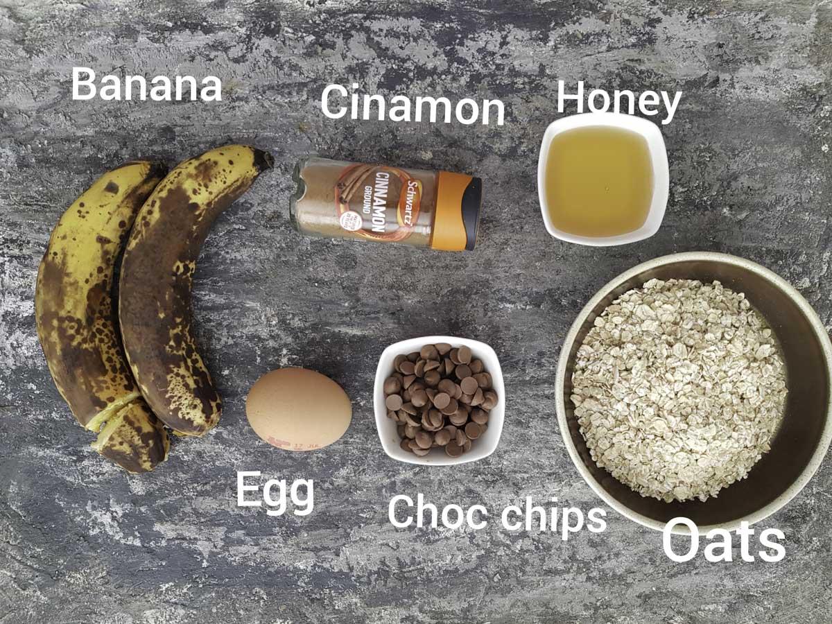 ingredients photo showing bananas, oats, honey, egg, chocolate chips, cinnamon