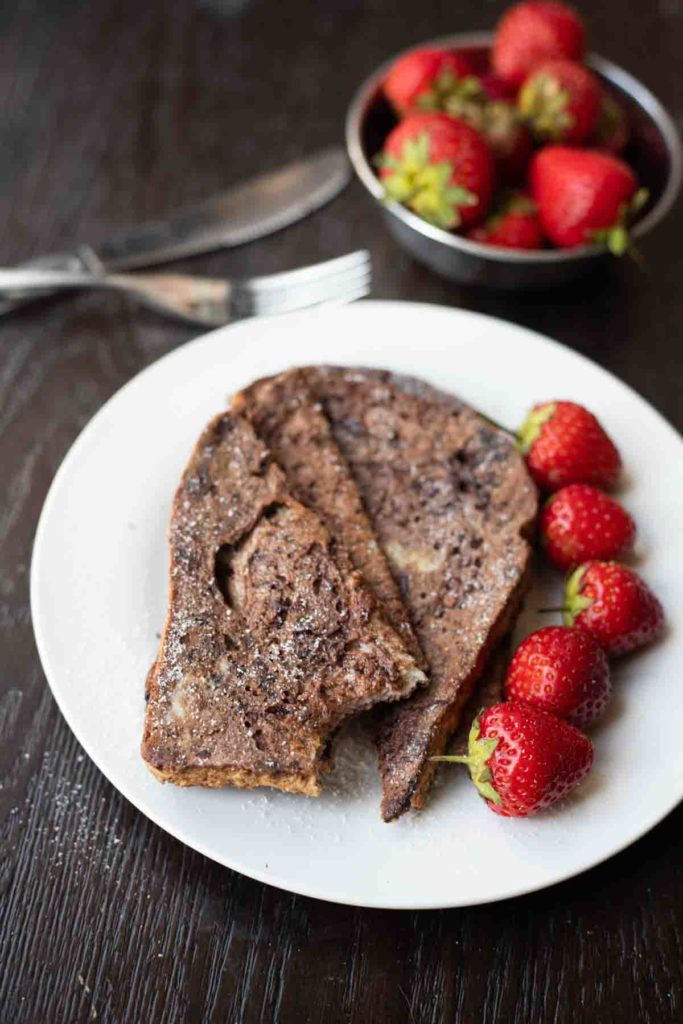 Chocolate french toast served with strawberries