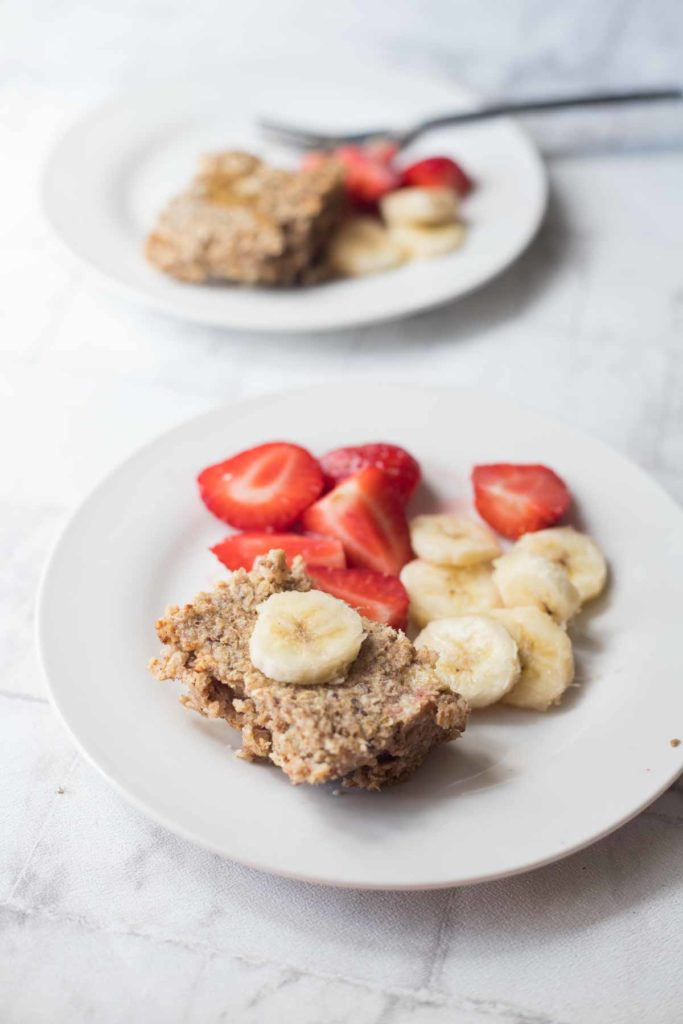 Peanut butter banana baked oatmeal served with fruit