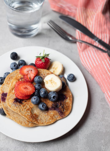 banana pancakes served with fruit