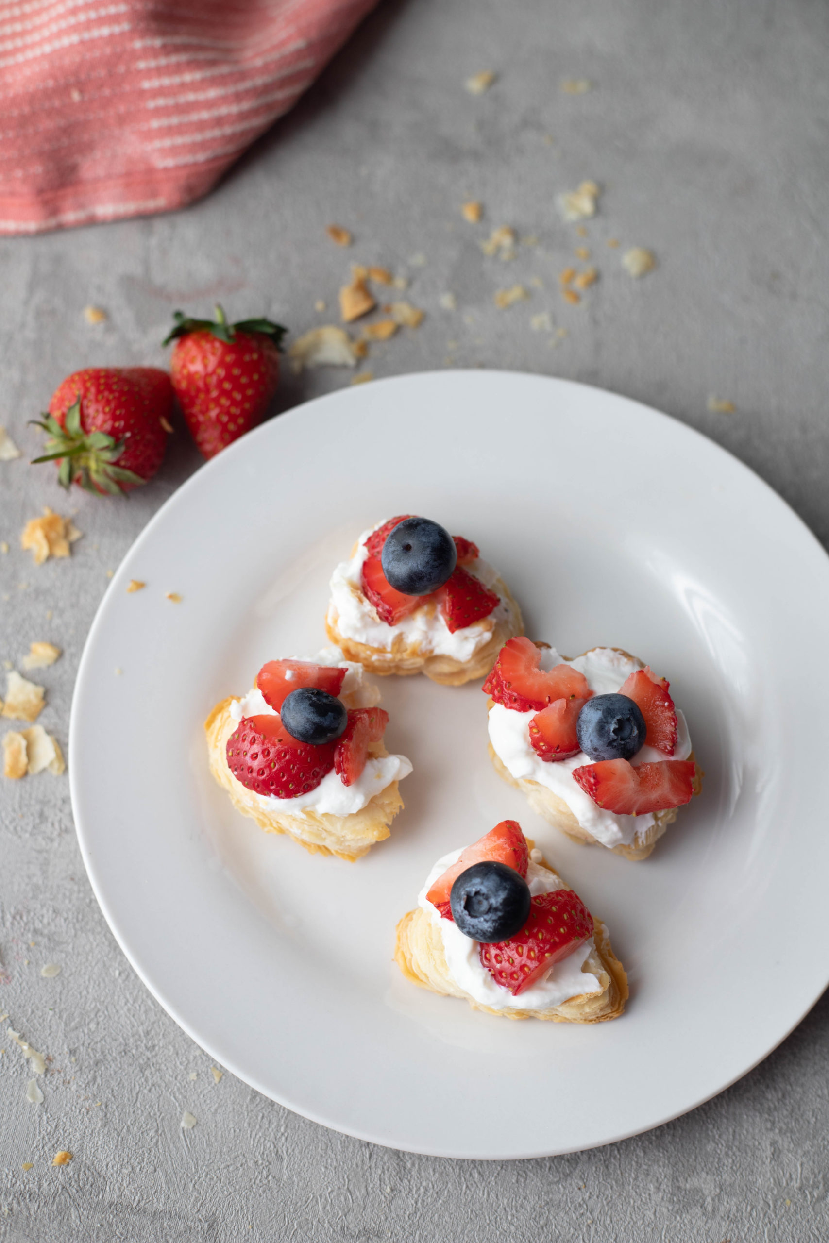 puff pastry bites with cream and berries