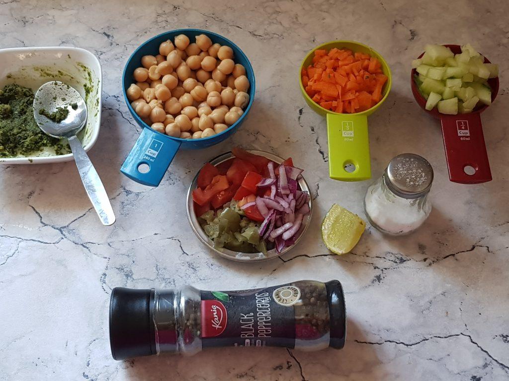 pesto, chickpeas,carrots cucumbers,tomato, red onion, jalapenos, lemon, salt, pepper