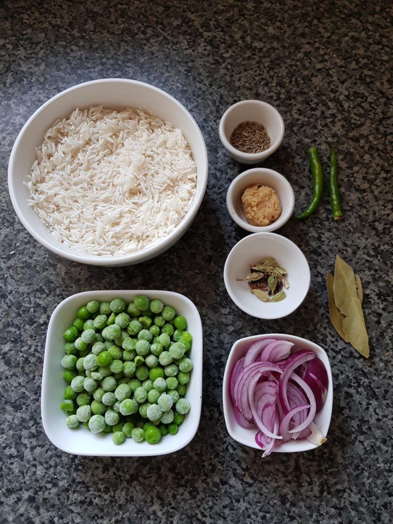 Green peas, basmati rice, onions, whole spices, ginger garlic paste,bay leaves, green chilli, cumin seeds