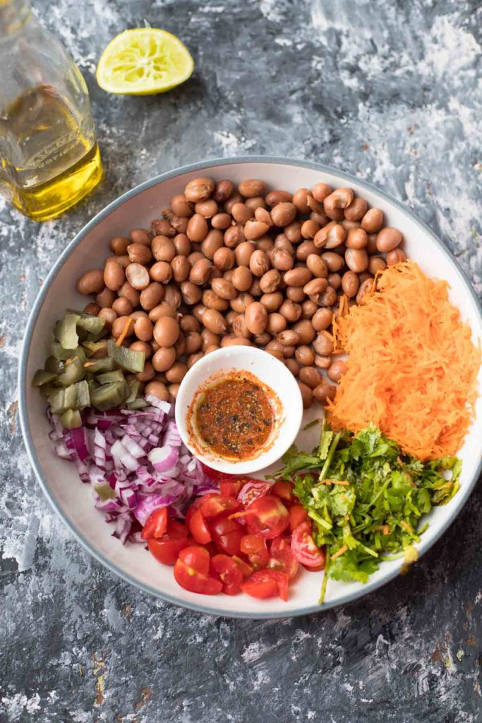 beans,grated carrot,chopped onion, tomatoes, cilantro, a small bowl of dressing