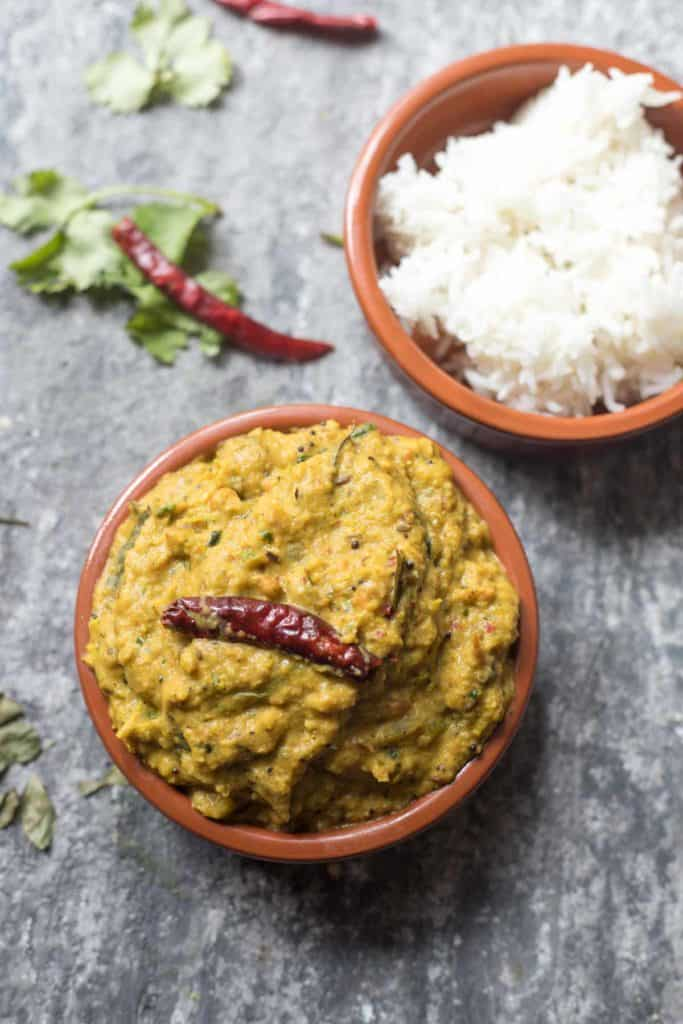 a bowl of green tomato chutney and a bowl of white rice