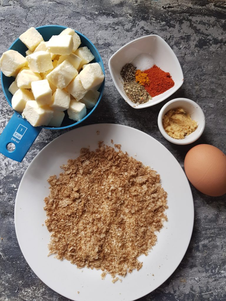 paneer popcorn ingredients - paneer cubes, spices, ginger garlic paste,egg, breadcrumbs