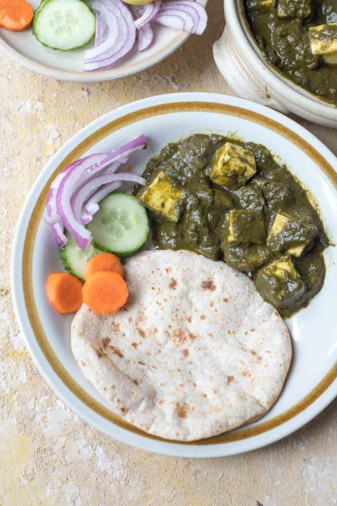 healthy palak paneer , chapati salad on a plate