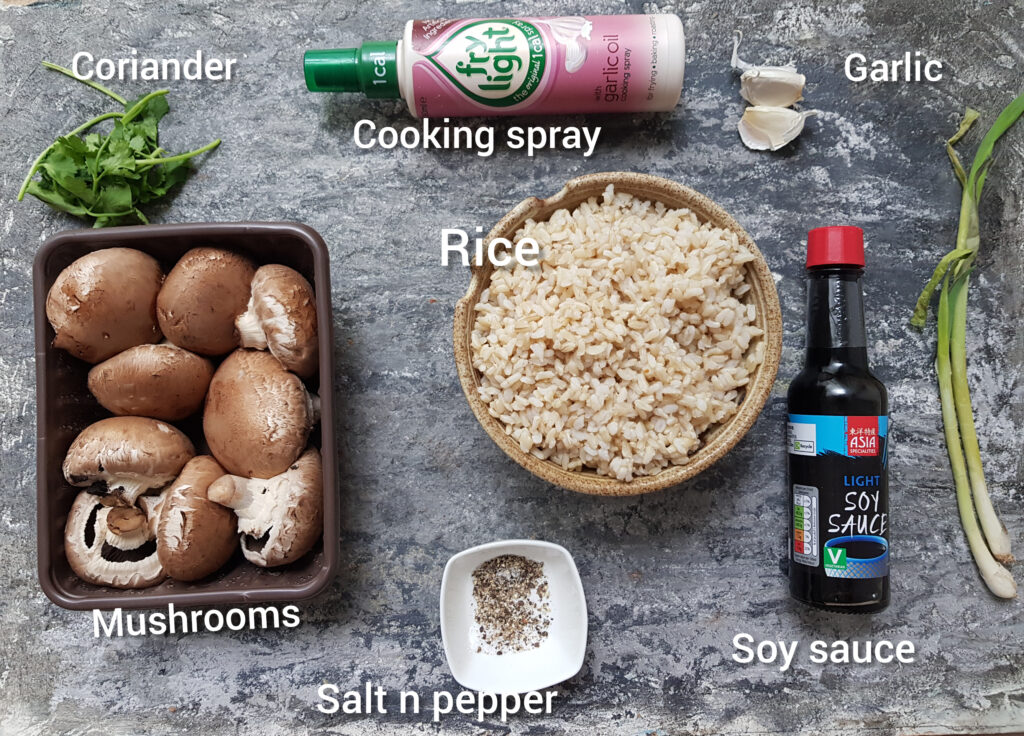 ingredients for mushroom fried rice, mushrooms, cooked brown rice, soy sauce, green onions, salt, pepper,cooking spray, coriander, garlic