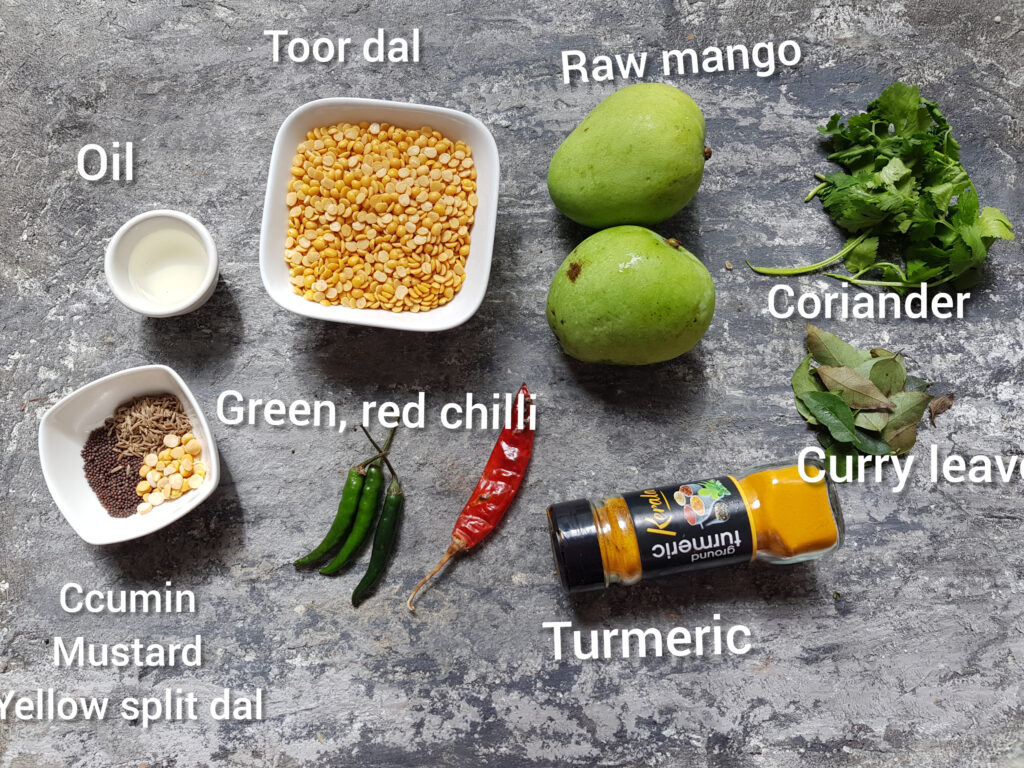 ingredients for raw mango dal recipe, mangoes, toor dal, chillis, oil, coariander, curry leaves, ground turmeric, cumin, mustard