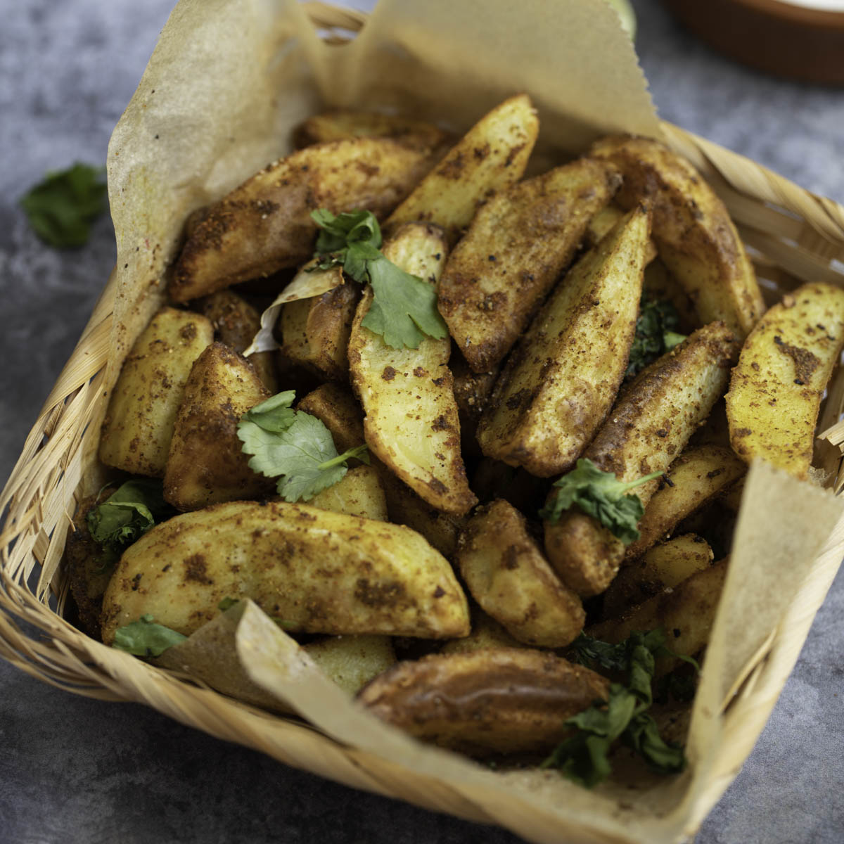 moroccan spiced potato wedges in a baking pape
