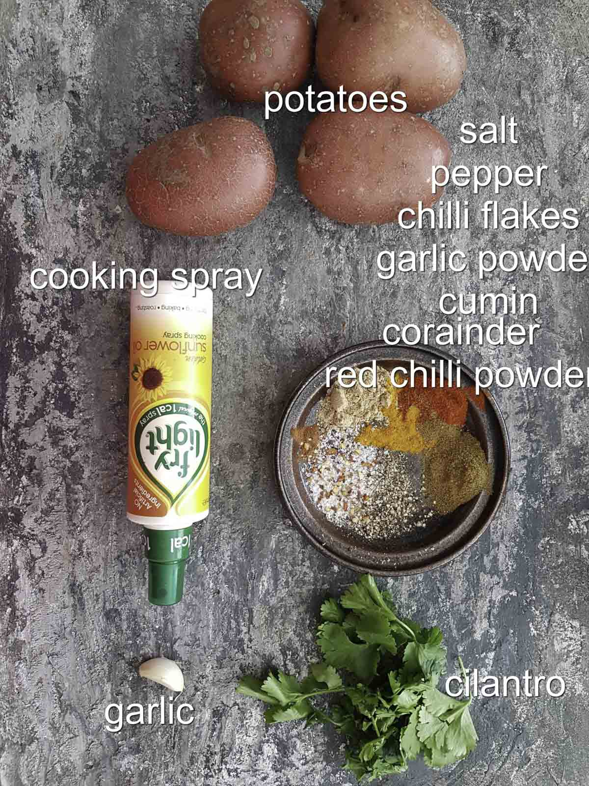 ingredients for Moroccan roasted potatoes recipe, potatoes, spices, garlic, cooking spray, cilantro