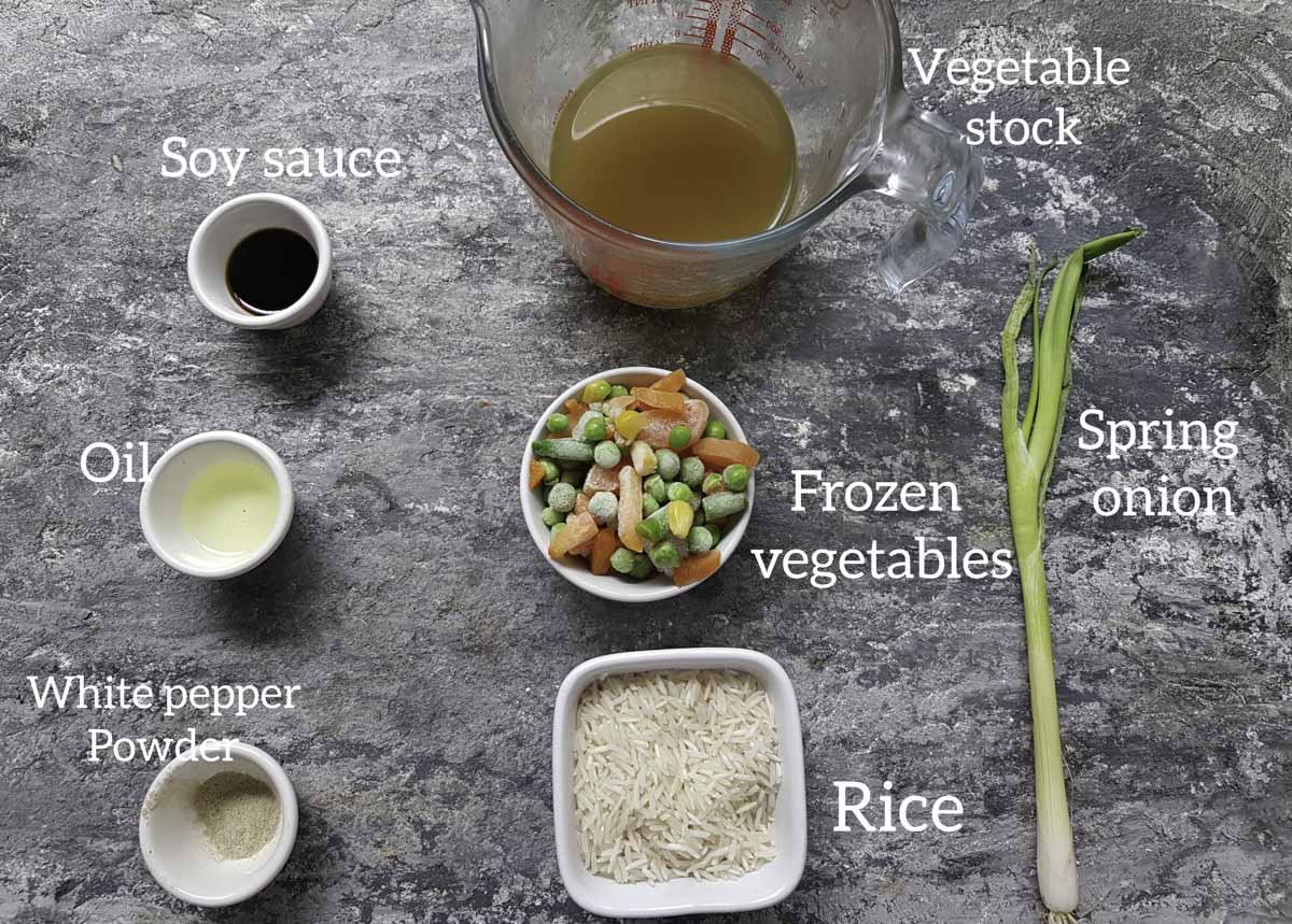 ingredients for baked fried rice , rice, vegetables, white pepper, oil, soy sauce, vegetable stock