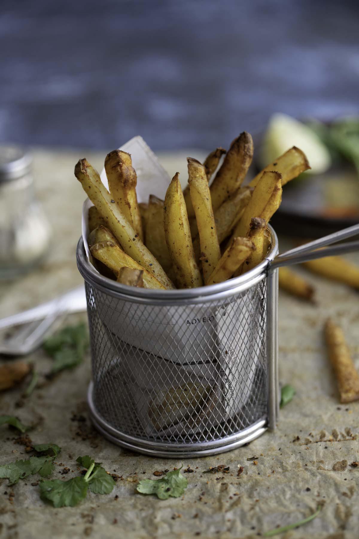 masala fries in a wire rack basket