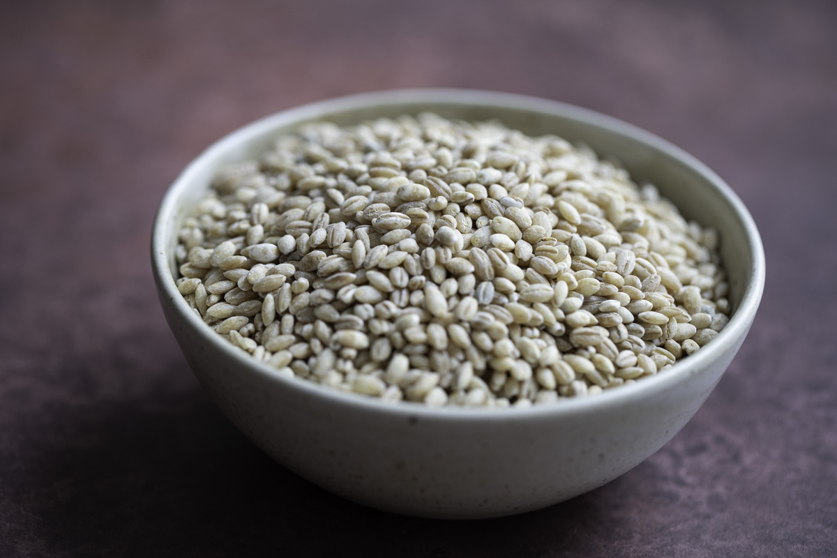 a bowl of uncooked pearl barley grains