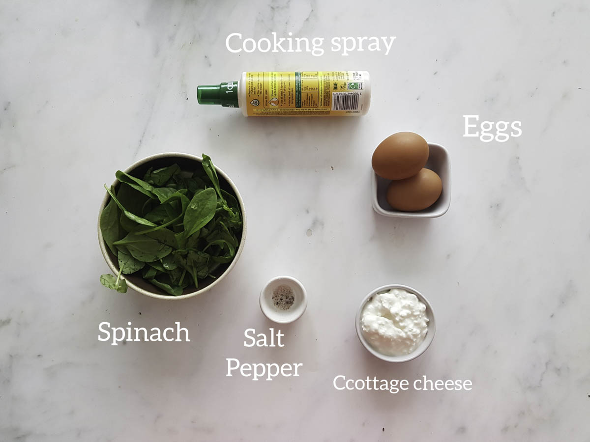 ingredients showcase spinach, cottage cheese, salt, pepper,egg, cooking spray