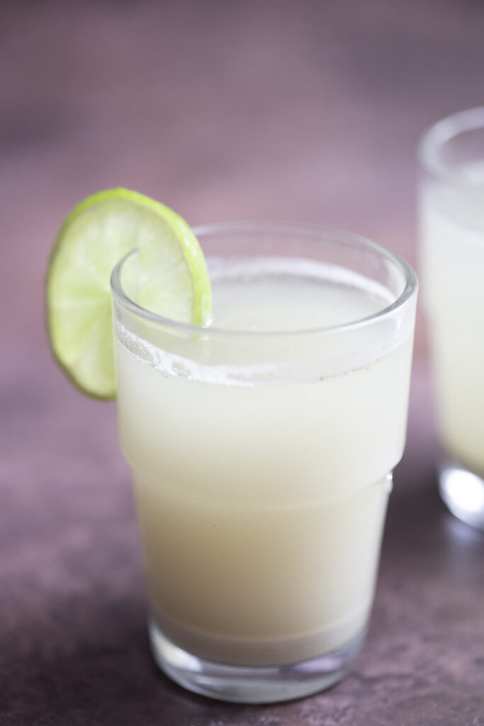 rice bran juice serve in a glass with lemon wedge